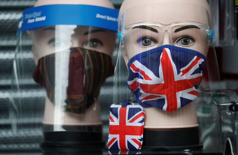 © Reuters. A Union Jack design face mask is seen for sale in the window of a shop amid the outbreak of the coronavirus disease (COVID-19) in Manchester