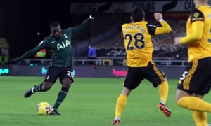 Tottenham Hotspur's French midfielder Tanguy Ndombele (L) scores his team's first goal.