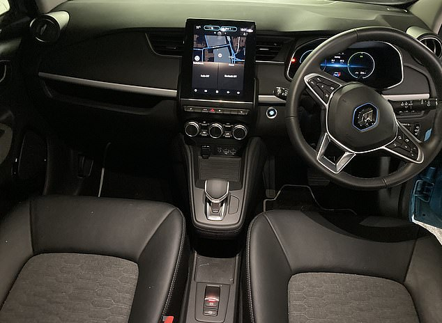 A 9.3 inch touch screen sits in the middle of the Zoe's dashboard, with switches and dials beneath and the simple electric gear shifter