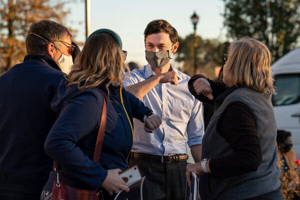 Jon Ossoff greeting supporters in November. Much is riding on whether Mr. Ossoff wins a Senate seat in Georgia next month.