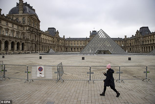 France was among the hardest hit Eurozone nations, according to the closely watched PMI index compiled by IHS Markit, amid concerns over the country's vaccination roll-out. Pictured:Metal barriers block the access to the pyramids of the closed Louvre museum in Paris