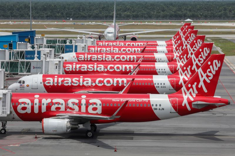© Reuters. FILE PHOTO: AirAsia planes are seen parked at Kuala Lumpur International Airport 2, during the movement control order due to the outbreak of the coronavirus disease (COVID-19), in Sepang