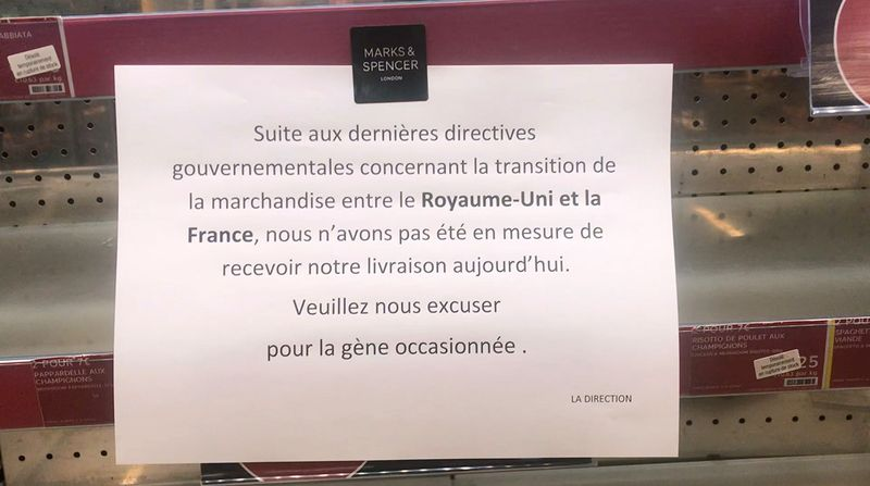 © Reuters. A sign on empty shelves at a Marks&Spencer store in Paris
