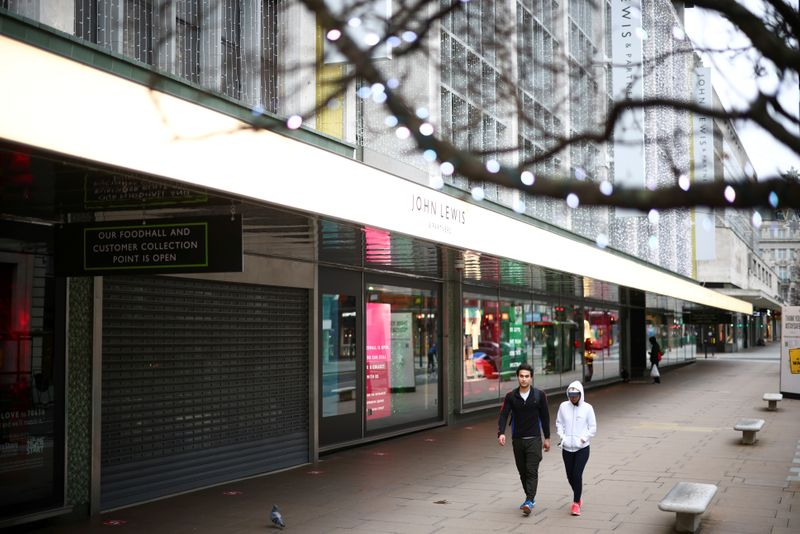 © Reuters. FILE PHOTO: People walk along Oxford Street as shops remain closed under Tier 4 restrictions, amid the coronavirus disease (COVID-19) outbreak, in London