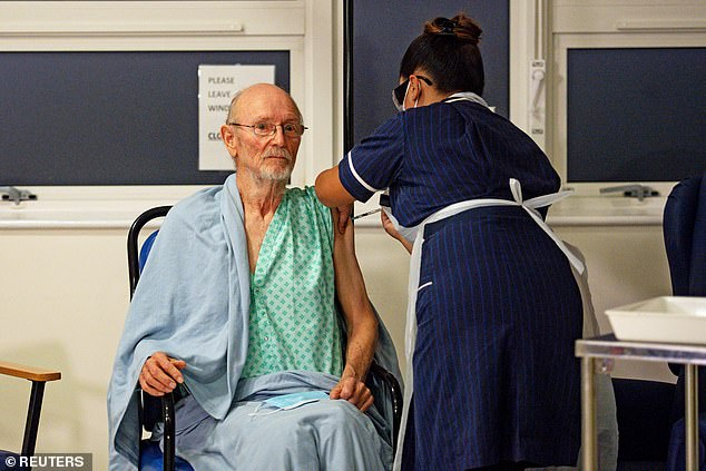 William Shakespeare, 81, was one of the first people in Britain to receive a Covid vaccine. He is pictured at a hospital in Coventry last year