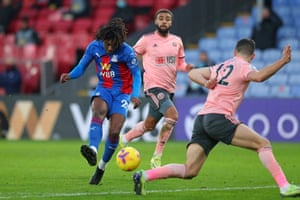 Crystal Palace's English midfielder Eberechi Eze (L) shoots to score his team's second goal.