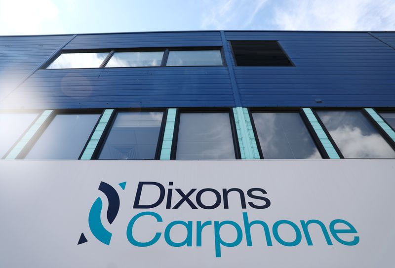 © Reuters. A sign displays the logo of Dixons Carphone at the company headquarters in London
