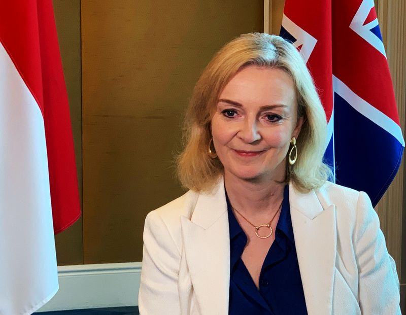 © Reuters. FILE PHOTO: British trade minister Liz Truss speaks to Reuters after signing a free trade agreement with Singapore, in Singapore
