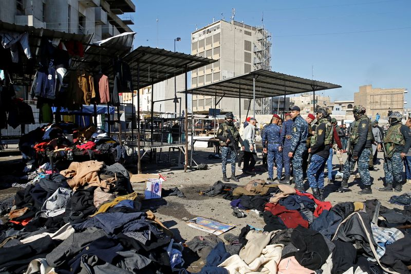 © Reuters. Site of a twin suicide bombing attack in a central market in Baghdad,