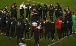 The Eintracht Frankfurt head coach Adi Hütter embraces the departing captain David Abraham in a post-match huddle following a 3-1 win against Schalke.