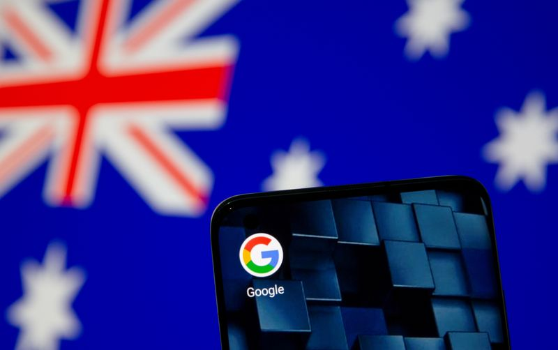 © Reuters. FILE PHOTO: Smartphone with google app icon is seen in front of the displayed Australian flag in this illustration taken