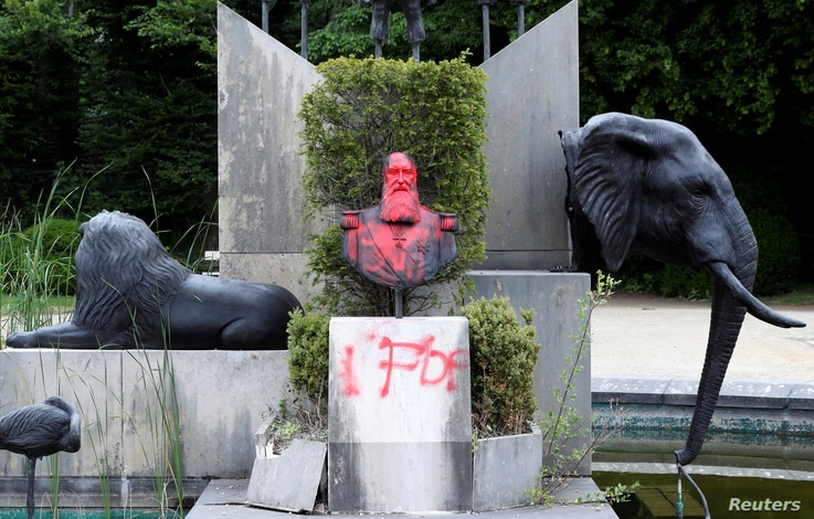A statue of former Belgian King Leopold II is vandalized in the park of the Africa Museum, in Tervuren, near Brussels, Belgium, June 9, 2020.