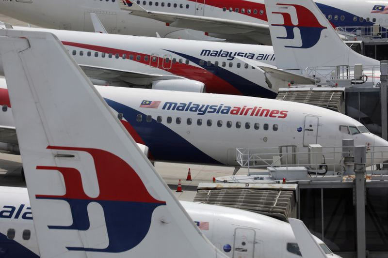 © Reuters. Malaysia Airlines planes are seen parked at Kuala Lumpur International Airport, amid the coronavirus disease (COVID-19) outbreak in Sepang