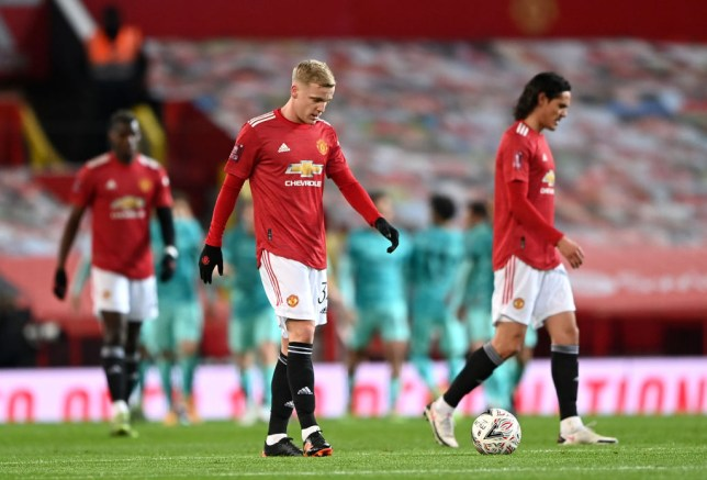 Donny van de Beek and Edinson Cavani of Manchester United cut dejected figures as Mohamed Salah of Liverpool scores their sides first goal  during The Emirates FA Cup Fourth Round match between Manchester United and Liverpool at Old Trafford on January 24, 2021 in Manchester, England. Sporting stadiums around the UK remain under strict restrictions due to the Coronavirus Pandemic as Government social distancing laws prohibit fans inside venues resulting in games being played behind closed doors.