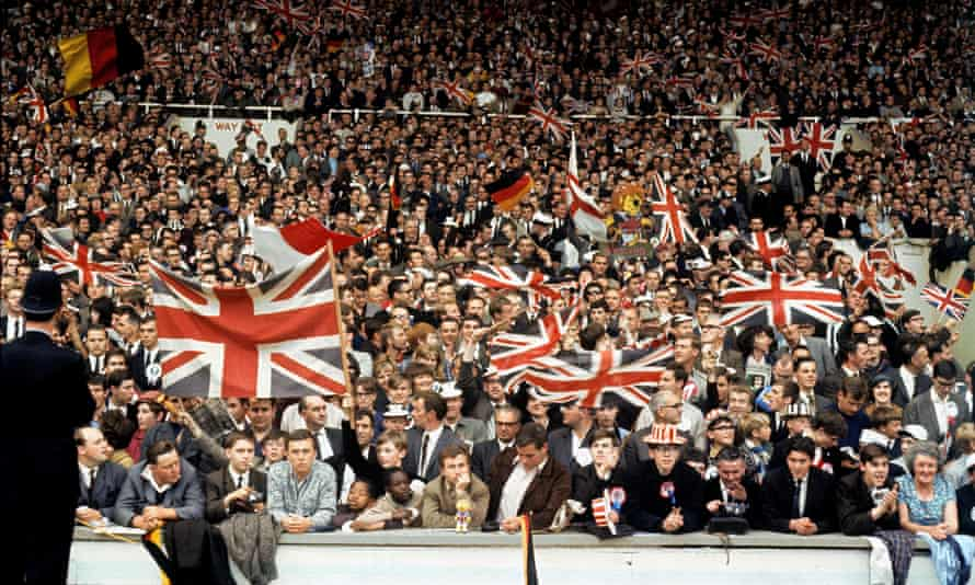 Spectators with Union Jack flags at the World Cup match between England and West Germany at Wembley in London, 1966.