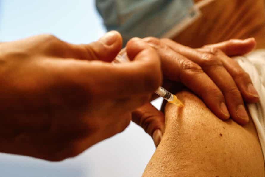 A nurse administers a dose of the Pfizer-BioNTech Covid-19 vaccine.