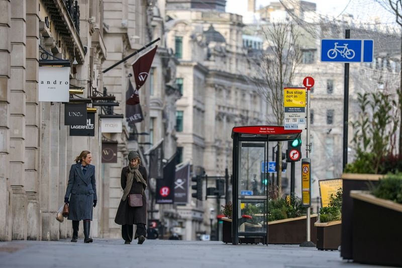 © Reuters. Two women walk down Regent Street in London