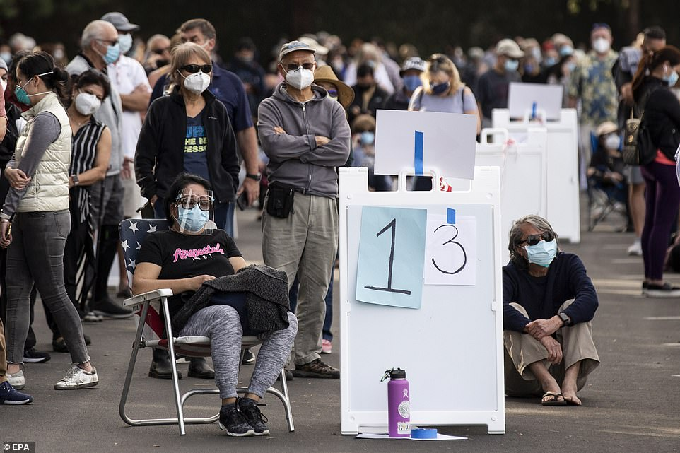 Disneyland in Anaheim, California, was turned into a mass vaccination site where thousands of people lined up to wait for shots - but it was shut down temporarily on Wednesday for the second day in a row due to high winds