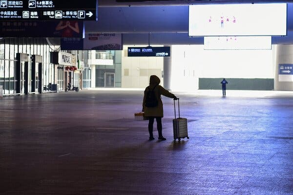 A passenger arrived at the nearly deserted train station in Wuhan on Jan. 23, 2020.