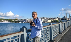 Author Orhan Pamuk on the Galata Bridge while he takes pictures of empty 'lockdown' streets in Istanbul, 23 May 2020.