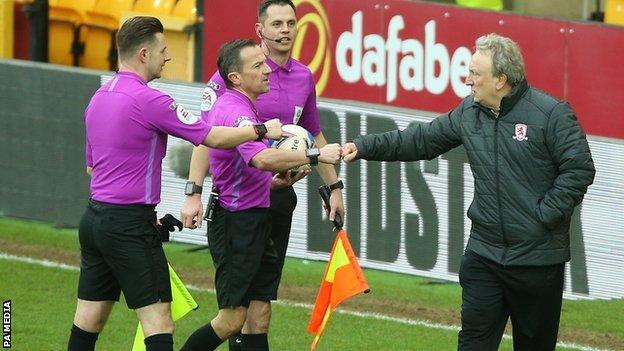 Middlesbrough boss Neil Warnock bumped fists with referee Keith Stroud and his team of officials at the end of the game at Carrow Road