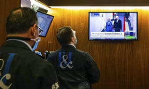 Traders on the New York Stock Exchange watching the presidential inauguration on Wednesday