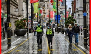 Police patrol the central shopping areas of Cardiff, Wales