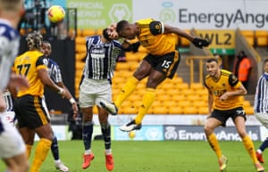 Wolves' Willy Boly bangs a header goalwards.