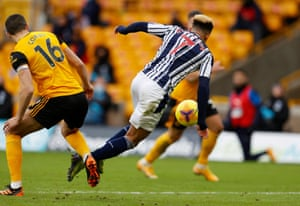 Wolverhampton Wanderers' Conor Coady fouls Callum Robinson and a penalty is awarded to West Bromwich Albion.