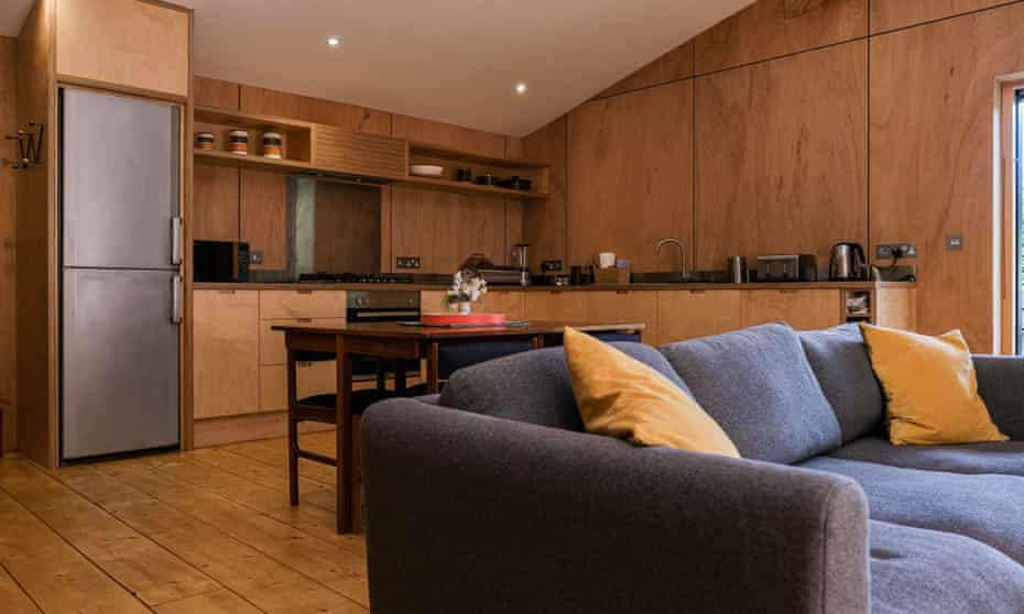 Grey and wood living area and kitchen