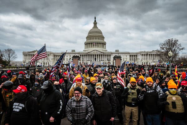 Pro-Trump protesters gather in front of the U.S. Capitol Building on January 6, 2021. Joseph Biggs is in the front row in the plaid jacket.