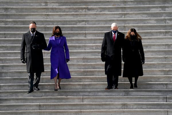 Vice President Kamala Harris and her husband Doug Emhoff left, and former Vice President Mike Pence and his wife Karen Pence leaving the Capitol after the inauguration.