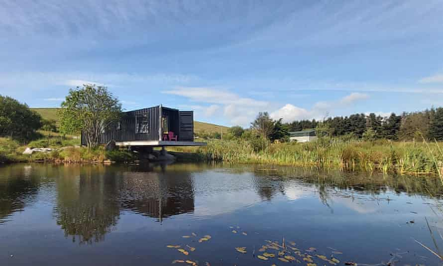 Cantilevered shipping container over water