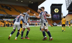 West Bromwich Albion players celebrate after the final whistle goes.