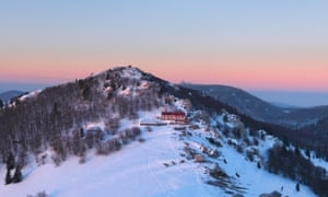 Zavižan mountain hut at sunset in clearer conditions.