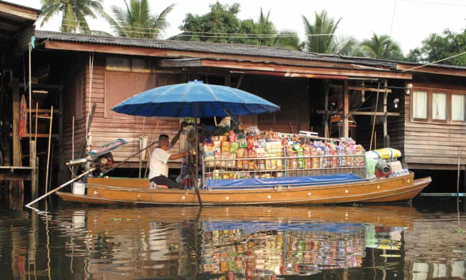 Bangkok's canal districts are still served by floating corner shops.