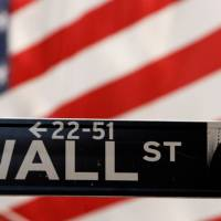 Dow hits an all-time high, bonds sell off as investors bet on recovery