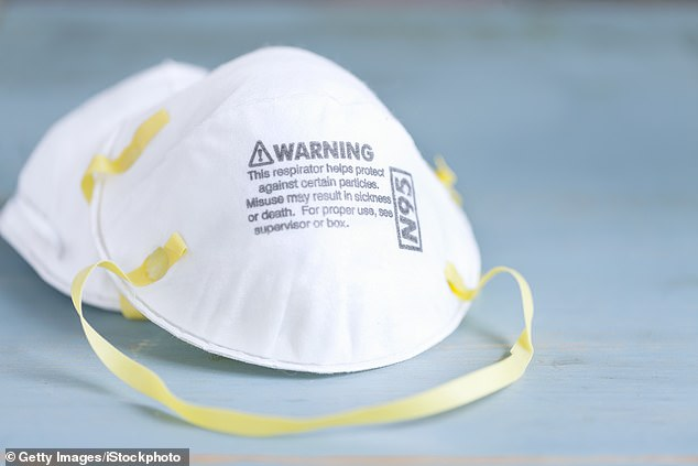 A memo was sent to the White House signed by a dozen health and safety experts, including four members of Biden's former coronavirus advisory board, calling on the CDC and OSHA to recommend the widespread use of N95 masks (left) and right