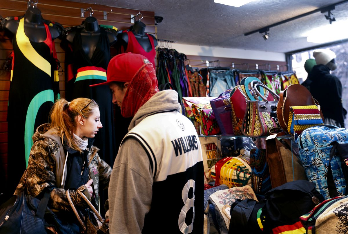 Justine Martinez and Gilbert Symonds shop at Twisted Roots in Salt Lake City on Friday, Feb. 12, 2021.