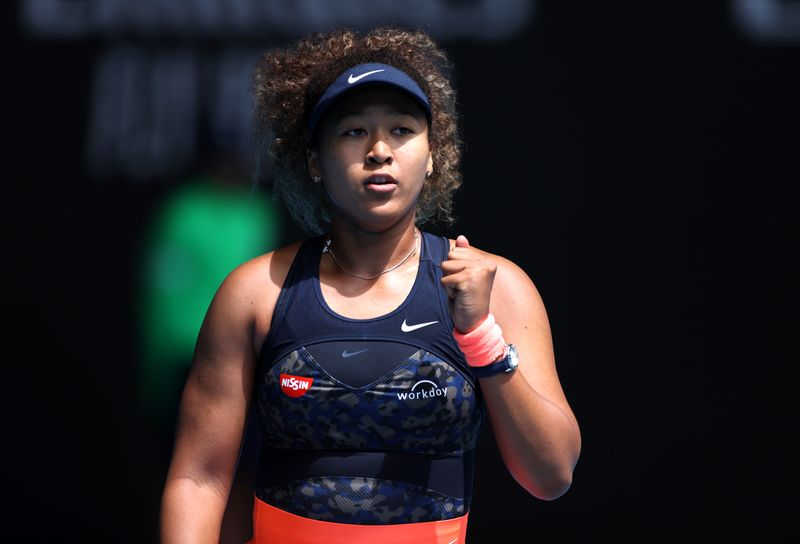 Osaka back from the brink to reach quarter-finals