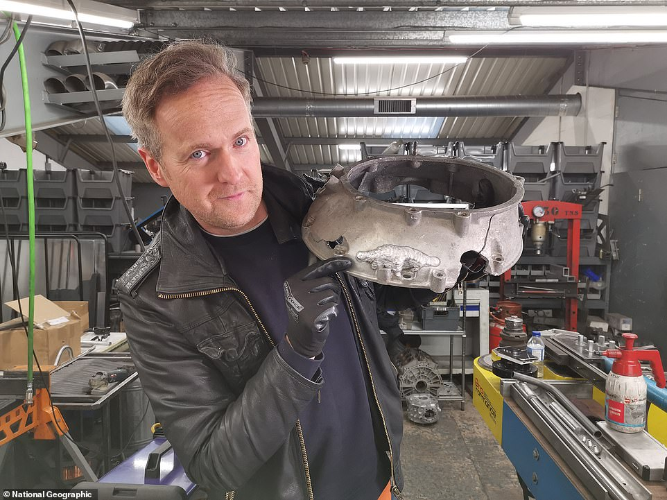 Tim shows the damage to thebell housing, which is part of the transmission that covers the flywheel and clutch. It was seemingly damaged beyond repair but the episode shows how it was rebuilt by Wood's team of skilled technicians