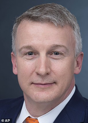 The signatories argue that there are millions of N95 masks 'sitting in warehouses' available for use among the general public. Pictured: Signatory Dr Rick Bright, who was the head of the Biomedical Advanced Research and Development Authority