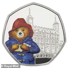 This coin features Paddington eating a marmalade sandwich outside the Tower of London