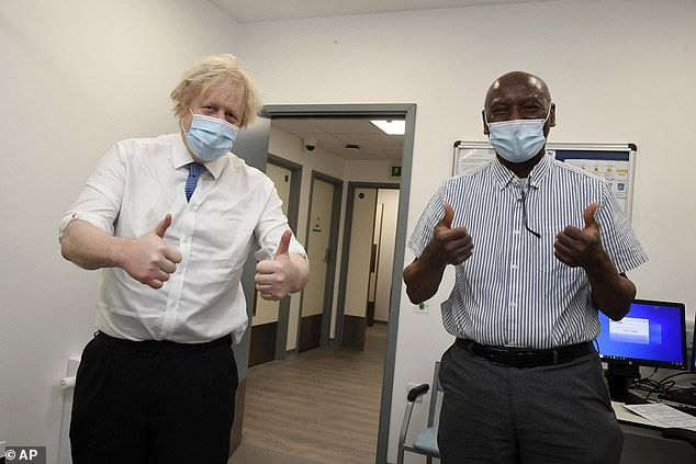 The Prime Minister posed for a photo with Silvester Biyibi, who had just received his coronavirus vaccine