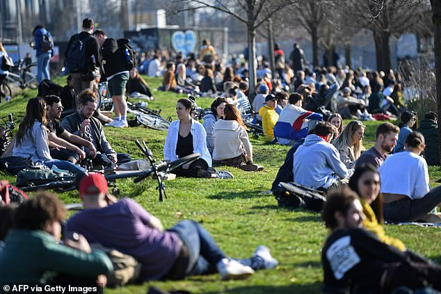 Britons took advantage of the good weather in Hackney Wick, east London yesterday, despite lockdown rules urging people to stay at home