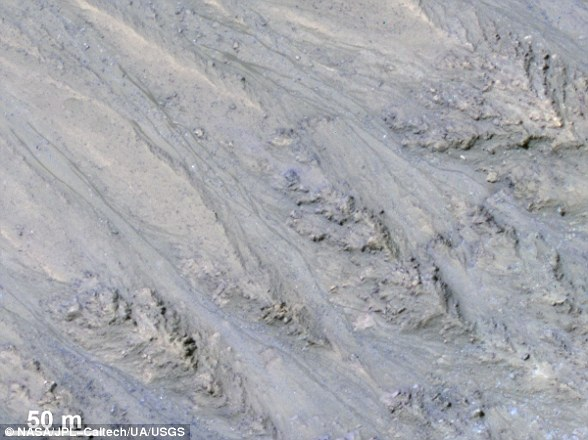 Features known as recurring slope lineae (RSL) were first identified in 2011 (pictured). These dark streaks populate the areas of Mars with a sharp incline. Researchers speculated that these may have been caused by the intermittent flow of liquid water
