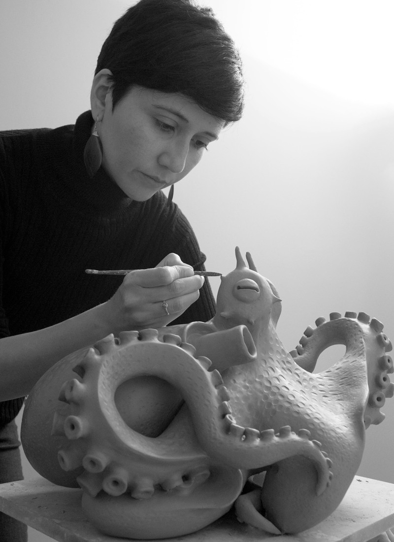 "Fernanda Oyarzun working on a sculpture of a coconut-octopus for the series ""Marine Consciousness""."