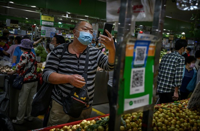 A Chinese shopper uses the WeChat Pay app in Beijing. While merchants can refuse to accept Alipay and WeChat Pay, they cannot decline to use the digital renminbi