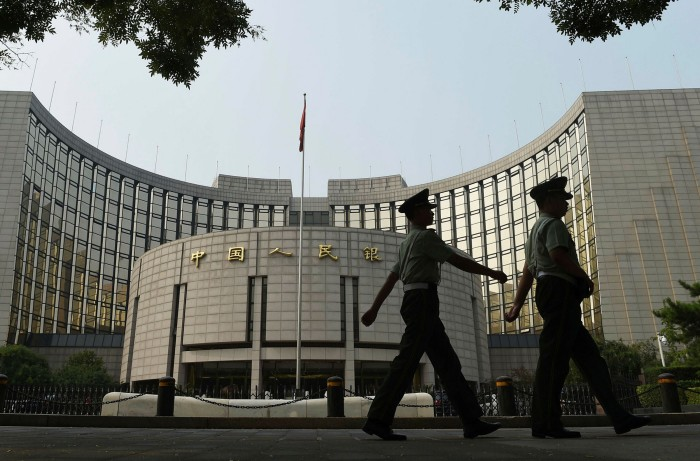 Police patrol in front of the People's Bank of China in Beijing. Samantha Hoffman of the ASPI says 'the [digital renminbi] is heavily about the party's ability to exercise control'
