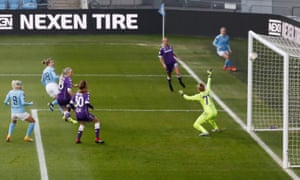 Manchester City's Ellen White scores their second goal.
